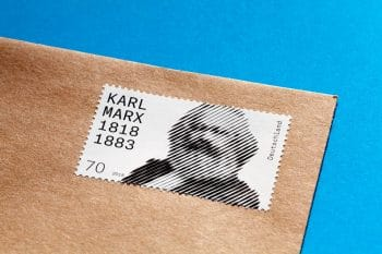Full image of Karl Marx stamp on package.