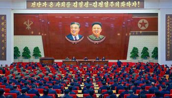 Kim Jung Un presides over a meeting of the Central Committee