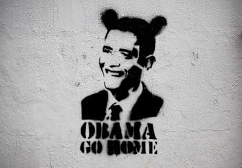 "An image of President Barack Obama wearing fake ears and the slogan ""Obama go home"" on a street wall in Caracas, Venezuela. (AP/Ariana Cubillos)"