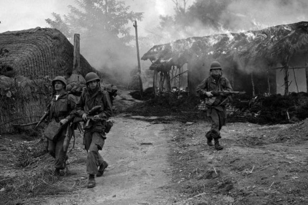 U.S. troopers move through burning shacks in the Sunchon/Sukchon area of North Korea, Oct. 20, 1950.  (AP Photo/Max Desfor)