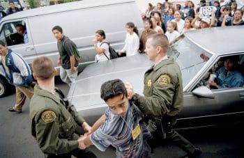 Los Angeles County Sheriff's deputies hold a young protester