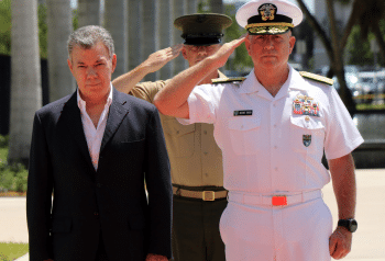 Colombian President Juan Manuel Santos, flanked by SOUTHCOM admirals, arrives at SOUTHCOM's Colombia military headquarters. Jose Ruiz | DoD