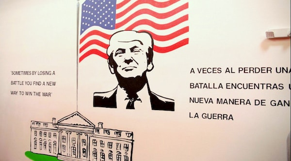 A mural at the Casa Padre migrant children's shelter in Brownsville, Texas, with a quote – in English and Spanish – from Donald Trump's 1987 book, The Art of the Deal. Source | Department of Health and Human Services