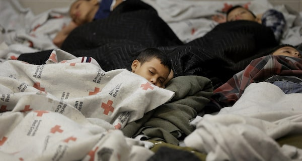 Child detainees sleep in a holding cell at a U.S. Customs and Border Protection processing facility, on June 18, 2014, in Brownsville,Texas.