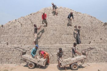People assembling a small Pyramid.