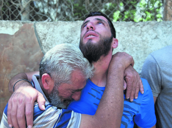 Ezza al-Din Tamimi's father and brother mourning