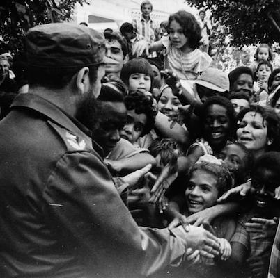 Fidel Castro greets a crowd during voting in the 1976 constitutional referendum. Photo- Liborio Noval