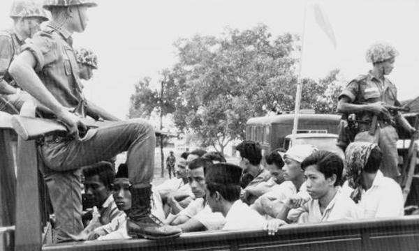 Indonesian soldiers round up civilians in Jakarta, 30 October 1965