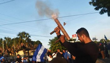 Masked individuals, armed with homemade mortars and bazookas block the streets and incite violence in Nicaragua. Photo- www.telemetro.com