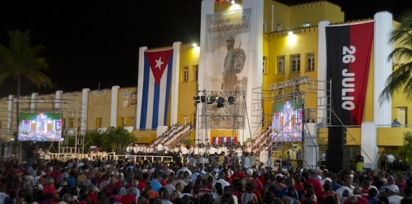 People attend an event celebrating Revolution Day in Santiago, Cuba, today