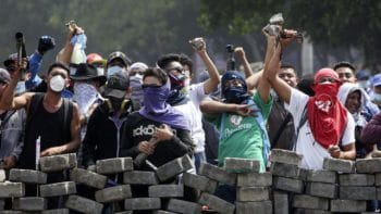 Protesters yell from behind the roadblock they erected as they face off with security forces near the University Politecnica de Nicaragua in Managua, Nicaragua, April 21, 2018. Source- Voice of America