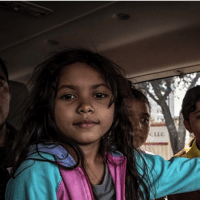Migrant children traveling with their parents