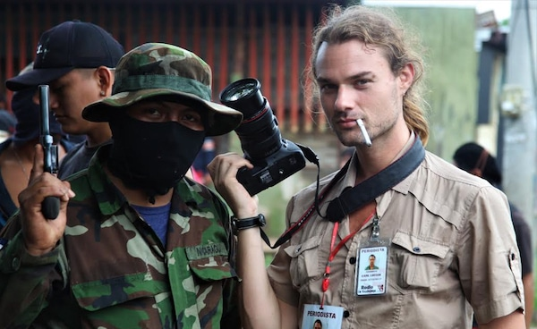 Carl David Goette-Luciak poses with an opposition gunman in the city of Masaya, Nicaragua. Photo | Edge of Adventure