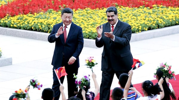 Chinese President Xi Jinping holds a welcome ceremony for his Venezuelan counterpart Nicolas Maduro before their talks in Beijing, capital of China, Sept. 14, 2018. Yao Dawei | Xinhua