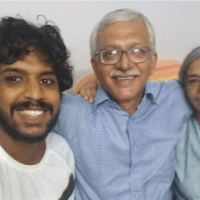 Sagar Abraham-Gonsalves takes a selfie with his parents Vernon Gonsalves and Susan Abraham as the police finished a raid on their home in Mumbai on Tuesday. Minutes later, Vernon Gonsalves was arrested. | Sagar Abraham-Gonsalves