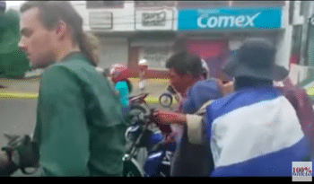 Goette-Luciak (left) appears briefly in a video photographing an opposition mob as it kidnaps and beats a man it mistook for a Sandinista paramilitary member. He has not published photos of the abuse or reported on it. Screenshot | YouTube