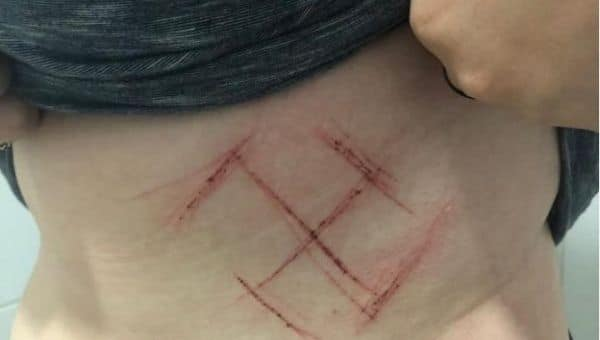 Bolsanaro supporters carve swastika into woman