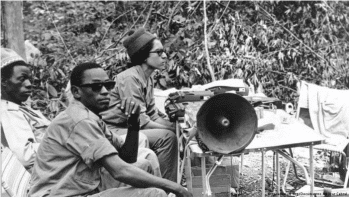 Amélia Araújo and her team taping the People's National Assembly in the Liberated Region of Madina de Boé in 1973. They are amplifying the voices of the movements.