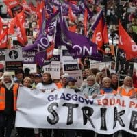 Strikers march to Glasgow Council's city chambers for a mass rally during a 48 hour strike by 8,000 GMB and Unison members over an equal pay claim