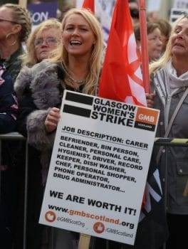 Women holding Glasgow Womens Strike poster (Photo Credit- Morning Star Online)