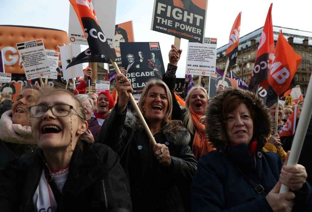 Women workers striking (Photo Credit- MorningStarOnline)