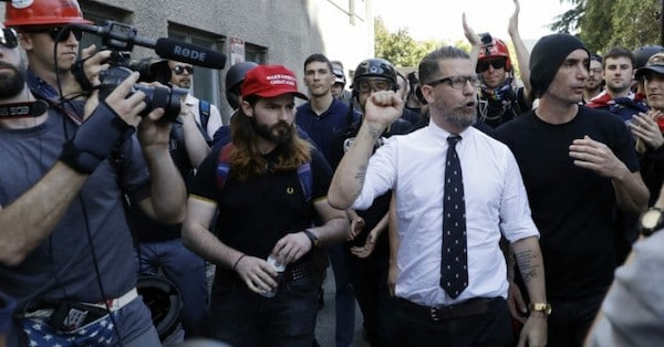 Proud Boys co-founder Gavin McInnes is surrounded by supporters at a rally in Berkeley, Calif. (Photo- Marcio Jose Sanchez : AP)