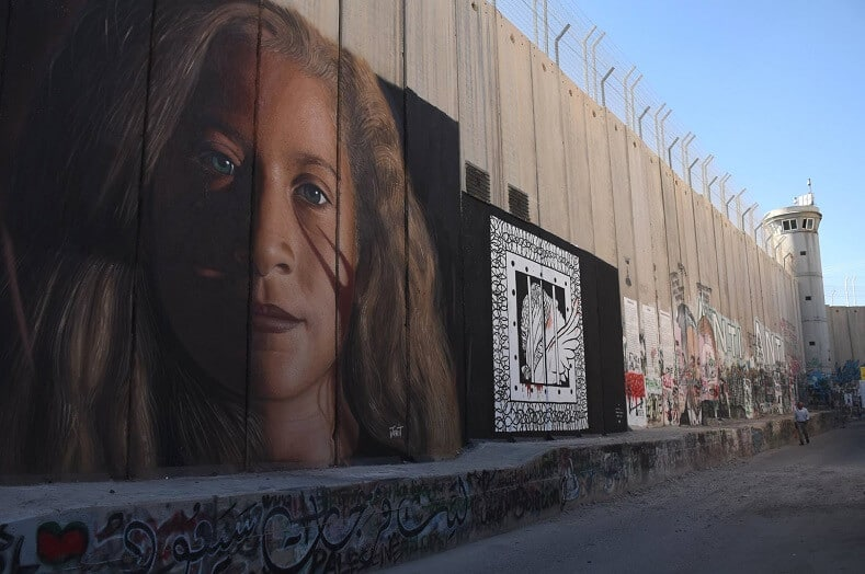 """""""I gave what I could, a drop in a sea of injustice,"""" Jorit said of his Ahed Tamimi mural during his interview with teleSUR. """"The Palestinian struggle is the world's struggle to free humanity from the hands of imperialism and colonialism."""" Photo:Jorit"""