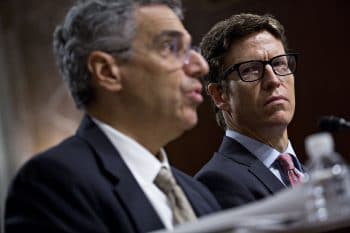 Andrew DeVore, vice president and associate general counsel with Amazon.com Inc., right, listens as Len Cali, senior vice president of global public policy with AT&T Inc., speaks during a Senate Commerce Committee hearing on consumer data privacy in Washington, D.C., on Sept. 26, 2018. Photo: Andrew Harrer/Bloomberg via Getty Images