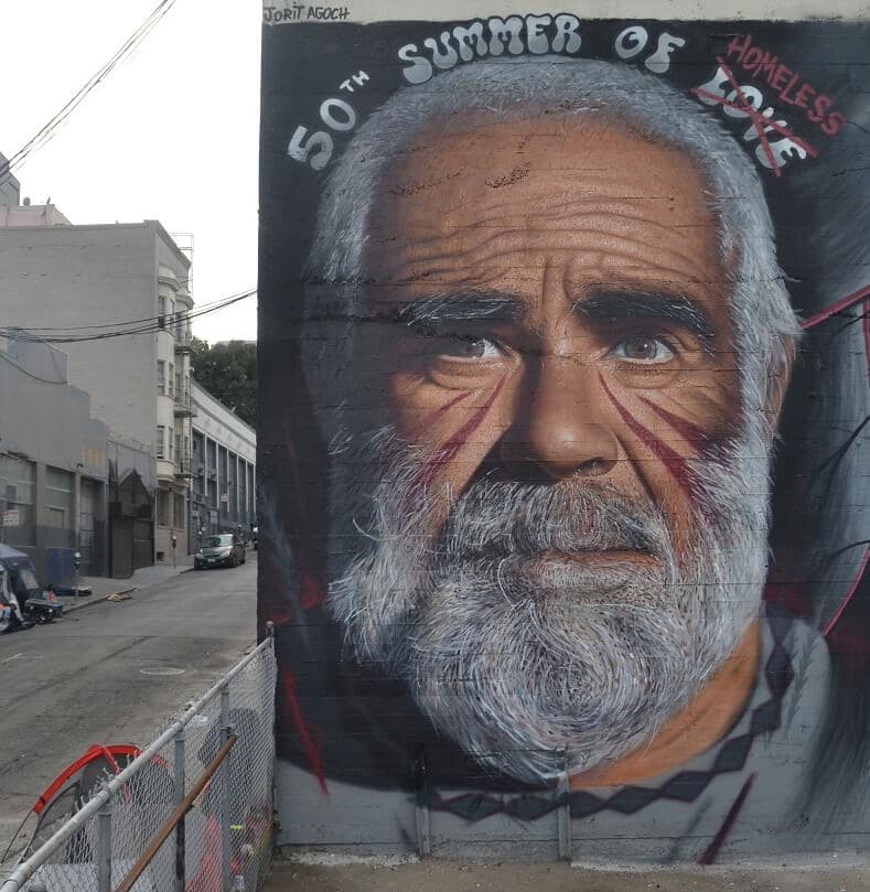 """Jorit also paints murals that show the human dimension of social issues like that of homelessness. """"Society is dangerously moving away from the very essence of the human being,"""" a move he said he condemns through his art. Photo:Jorit"""