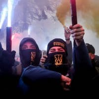 "Volunteers with the right-wing paramilitary Azov National Corps light flares during a rally on the snowy streets in front of the Ukrainian parliament in Kiev, Ukraine, Nov. 26, 2018. Protesters from far-right party National Corps brandished yellow-and-blue flags with the Ukrainian national trident symbol, and a banner reading 'Don't back down!"" Efrem Lukatsky 