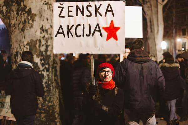 Ankica Čakardić holding a banner Women's action, photo by Ivan Maričić (private collection).