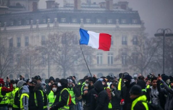 Demonstrators gather near the Arc de Triomphe in Paris during a protest on Saturday.