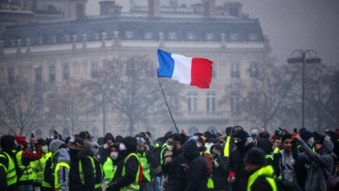   Demonstrators gather near the Arc de Triomphe in Paris during a protest on Saturday   MR Online