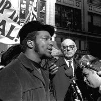 At a rally outside the U.S. Courthouse October 29, 1969, Dr. Benjamin Spock, background, listens to Fred Hampton, chairman of the Illinois Black Panther party. It was part of a protest against the trial of eight persons accused of conspiracy to cause a riot during the Democratic National Convention in 1968. Photo: AP Photo
