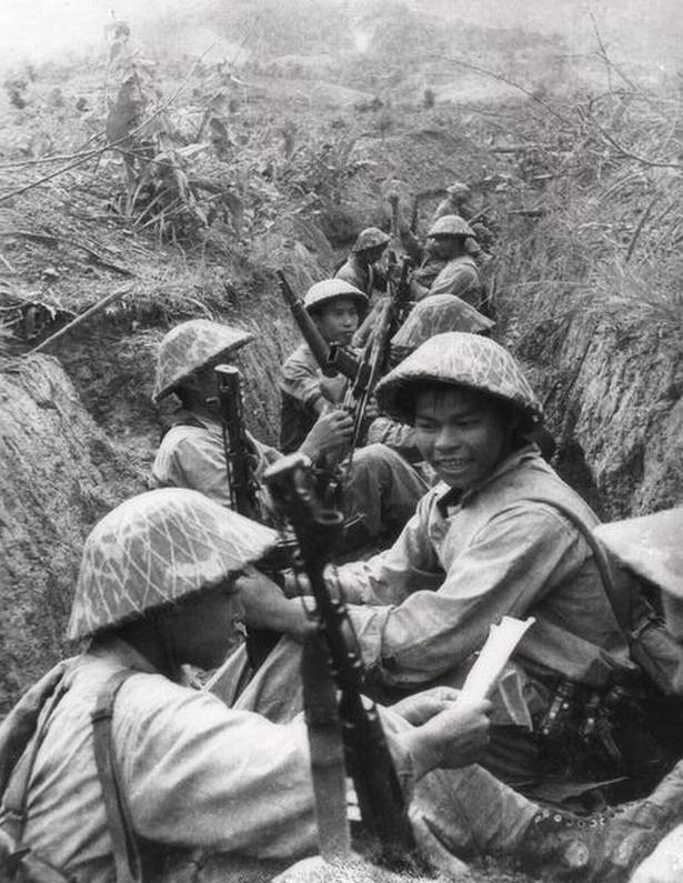 This picture taken in 1954 shows Vietnamese soldiers resting between two advances in a trench at Dien Bien Phu