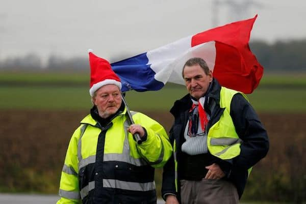 The Globe and Mail Protesters wearing yellow vests, the symbol of a French drivers' protest against higher diesel fuel prices, occupy a roundabout in Somain, France, Dec.