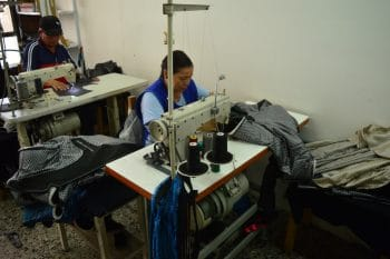 Peasant woman working in a textile cooperative