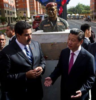 China's President Xi Jinping, right, and Venezuela's President Nicolas Maduro speak
