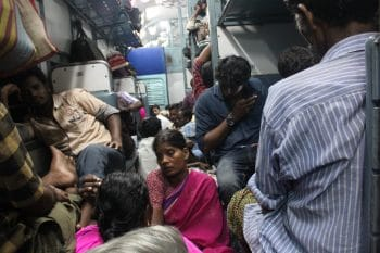 Migrant workers returning home from Cochin in a train