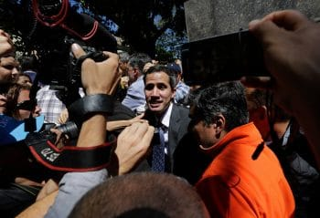 Juan Guaido speaks to the press as he leaves a public plaza where he spoke in Caracas, Venezuela, Jan. 25, 2019. Fernando Llano | AP