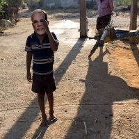 A boy in a Modi mask