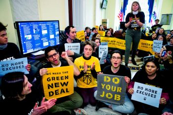Activists occupy the office of Nancy Pelo as they try to pressure Democratic support for a sweeping agenda to fight climate change on Capitol Hill, Dec. 10, 2018. J. Scott Applewhite | AP
