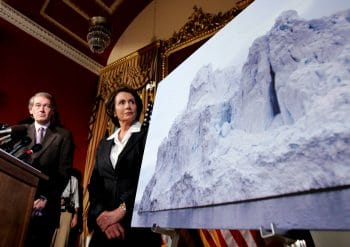 House Speaker Nancy Pelosi looks at a photo of an iceberg during a news conference on Capitol Hill in Washington, June 1, 2007, to discuss global warming. Susan Walsh | AP
