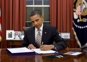 "Barack Obama signing an executive order declaring Venezuela ""an unusual and extraordinary threat"""