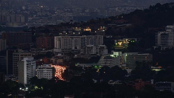 A major power outage left Caracas (pictured) and most of the country in the dark after an alleged cyber attack on Thursday (AFP)