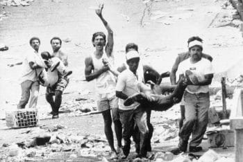 Residents of Petare, a shanty-town in eastern Caracas, bring down the bodies of two men killed in riots on Feb. 28, 1989. Seventeen people were reported killed there, according to unofficial sources. (AP Photo/Fresso)