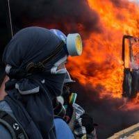 Demonstrators set a truck on fire in Caracas, Venezuela (February 18, 2018)
