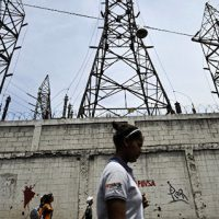 A woman walks in front of electricity pylons in Caracas, Venezuela (File)