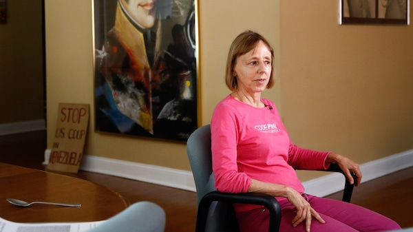 CodePink co-founder Medea Benjamin sits for an interview with The Associated Press, Wednesday, April 24, 2019, in the shuttered Venezuelan Embassy in Washington. Activists have been staging a round-the-clock vigil inside the embassy, occupying it to prevent representatives of Juan Guiado, opposition leader and self-proclaimed interim president, from taking over the building. (AP Photo/Patrick Semansky)