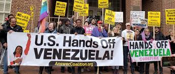 Activists gather in front of the Venezuelan embassy in Washington, DC in March, 2019.
